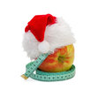 Apple with a measuring meter in cap santa claus Royalty Free Stock Photo