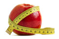 Apple and measuring tape red over white the concept of diet fitness Stock Image