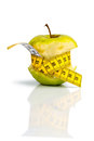 Apple with measuring tape a symbolic photo for diet and healthy vitamin rich diet Royalty Free Stock Photo