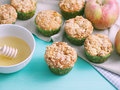 Apple muffins with spiced crumb on on green pastel wooden table table napkins and an Royalty Free Stock Image