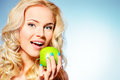 Apple natural portrait of a beautiful young woman eating Stock Image