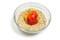 Apple on oat flakes in a glass bowl top front view red beige white yellow colors Stock Photo