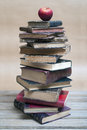 Apple and old books on a pile of stacked Royalty Free Stock Photography