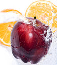 Apple and orange splash Royalty Free Stock Images