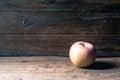 Apple på trä Royaltyfria Foton