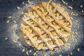 Apple pie with almonds and icing sugar Stock Photography