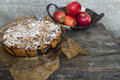 Apple pie and apples in basket Stock Photo