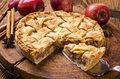 Apple pie as closeup on a wooden cutting board Royalty Free Stock Photography
