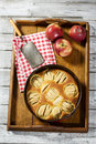 Apple pie in baking dish on tablet Royalty Free Stock Photo