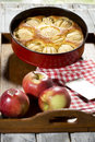 Apple pie in baking dish on tablet Royalty Free Stock Photography