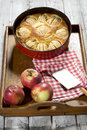 Apple pie in baking dish on tablet Stock Images