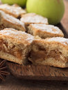Apple pie with cinnamon close up shot of and blurred apples Stock Photos