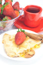Apple pie, cinnamon, a cup of tea and strawberries Stock Photography