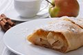 Apple pie with cinnamon on the white plate closeup Stock Image