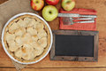 Apple pie with heart shaped crust topping with chalkboard a Stock Photos