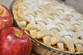 Apple pie homemade surrounded by red apples Stock Images