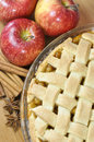 Apple pie homemade surrounded by red apples anise and cinnamon sticks Stock Images