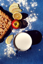 Apple pie with milk on the blue background Royalty Free Stock Photo