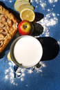 Apple pie with milk on the blue background Stock Images