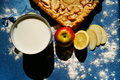 Apple pie with milk cup of on the blue background Royalty Free Stock Photography