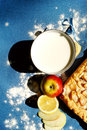 Apple pie with milk cup of on the blue background Royalty Free Stock Photos