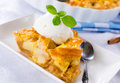 Apple pie traditional american with ice cream on the top Stock Photos