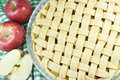 Apple pie unbaked homemade surrounded by red apples Royalty Free Stock Image