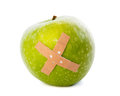 Apple with plaster Stock Image