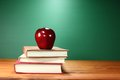 Apple Plus Stack of Books on A Desk for Back to School Royalty Free Stock Photo