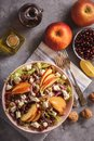 Apple salad with walnuts, pomegranate amd goat cheese. Royalty Free Stock Photo