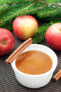 Apple sauce with cinnamon and fresh apples for christmas dessert top view vertical Stock Photo
