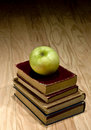 Apple and school textbooks Royalty Free Stock Photos