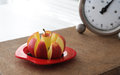 Apple slicer and vintage kitchen scale in front of Stock Photography