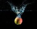 Apple with splash Stock Image