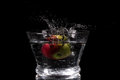 Apple splashing in water on a black background Royalty Free Stock Photos