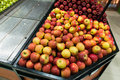 Apple stall in big supermarket Stock Photo