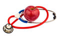 Apple and stethoscope an a with a doctor representative photo of healthy vitamin rich diet Stock Photography