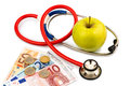 Apple and stethoscope an a with a doctor representative photo of healthy vitamin rich diet Royalty Free Stock Photo
