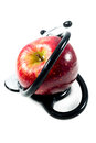 An apple with stethoscope on white background Stock Photo