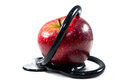 An apple with stethoscope on white background Royalty Free Stock Photography