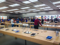 Apple store toronto september customers browse the in toronto canada on september apple's newest iphones the c and the s go on Stock Photo