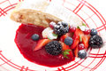 Apple strudel and fresh berries piece with berry sauce Royalty Free Stock Image