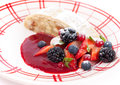 Apple strudel with sauce from fresh berries piece and berry Royalty Free Stock Photo