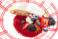 Apple strudel and summer berries piece of with berry sauce Stock Image