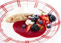 Apple strudel and summer berries piece of with berry sauce Stock Photography