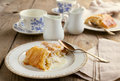 Apple strudel with vanilla cream sause. Selective focus Royalty Free Stock Photo