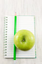 Apple on top of a notebook. Royalty Free Stock Photo