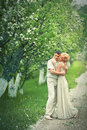 Apple tree garden beautiful couple in Royalty Free Stock Photos