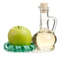 Apple vinegar in the glass bottle with fresh apples isolated on white background Royalty Free Stock Photo