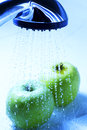 Apple wash under water wet Royalty Free Stock Photography